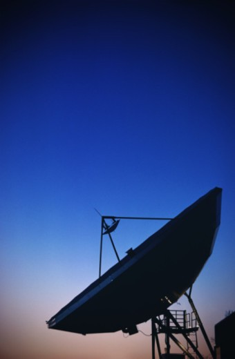 The parabolic reflector and feedhorn of a satellite receiver dish : Stock Photo
