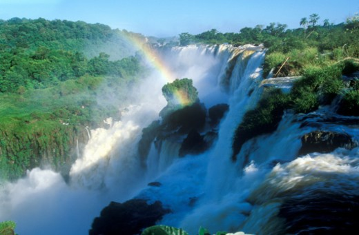 Brazil and Argentina border, rainbow over Iguazu Waterfalls : Stock Photo
