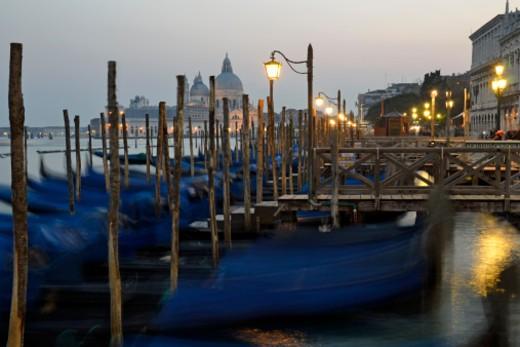 Moored gondolas at dusk, Santa Maria Della Salute church in background, Venice, Italy (long exposure) : Stock Photo