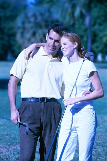 view of a couple hugging at a golf course : Stock Photo