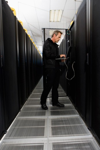 Computer technician working in server room in Cape Town, South Africa : Stock Photo