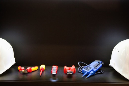 Close-up of electrician tools and hardhats : Stock Photo
