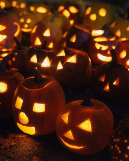 Various lit up Jack-O-Lantern faces for Halloween : Stock Photo