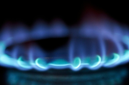 Stock Photo: 1491R-1173459 Lit blue gas stove burner, close up