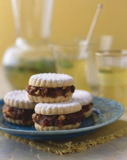 Stock Photo: 1491R-1173585 Sandwich cookies filled with candied bacon and walnuts and sprinkled with powdered sugar