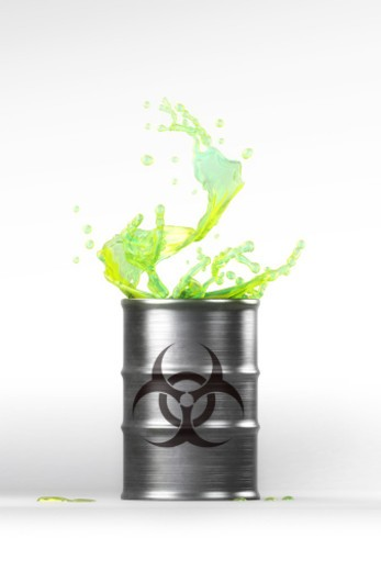 Barrel with liquid splash and biohazard symbol : Stock Photo