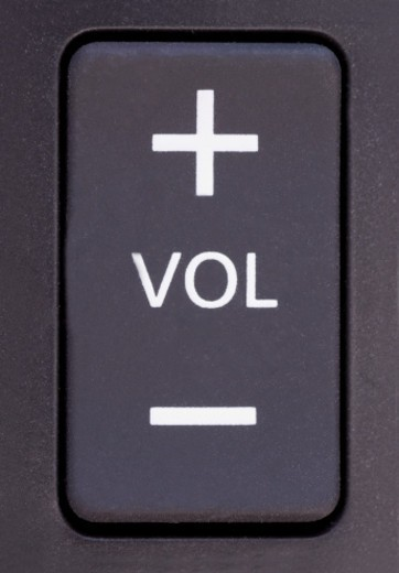 Volume Control Button : Close up of the volume control button on a tv remote
