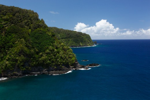 The Hana Highway is an almost 60 mile stretch of road that connects the small town of Hana to the rest of Maui. : Stock Photo