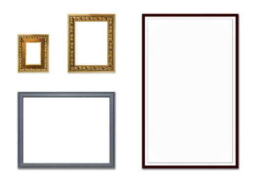 Stock Photo: 1491R-1174104 Assortment of various picture frames hanging on a wall. The frames are empty and they are made of a variety of materials. Also their size varies a lot.