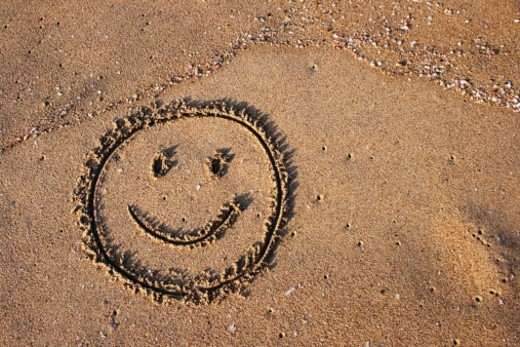 Smile on the sand : Stock Photo
