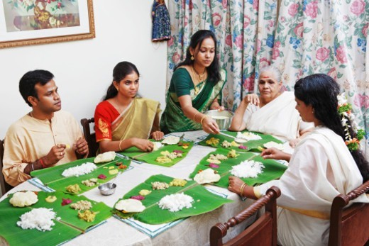 View of a family having onam sadhya together : Stock Photo