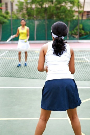 Stock Photo: 1491R-1175055 Women playing tennis