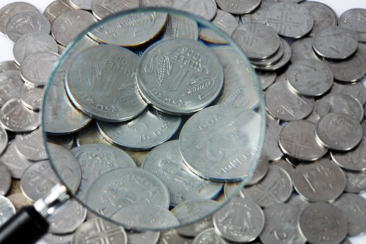 Stock Photo: 1491R-1175112 Close up of coins through magnifying glass