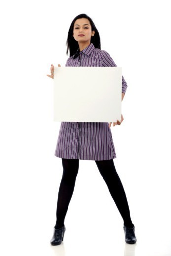 Young woman holding a placard : Stock Photo