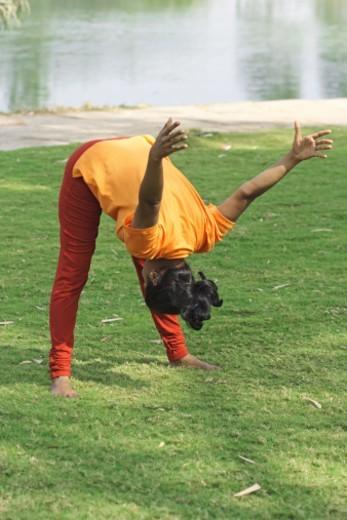 A woman doing yoga exercises : Stock Photo
