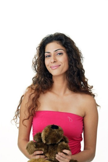 Young woman holding a soft toy. modelling : Stock Photo