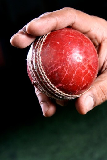 Stock Photo: 1491R-1176357 Person holding a Cricket ball