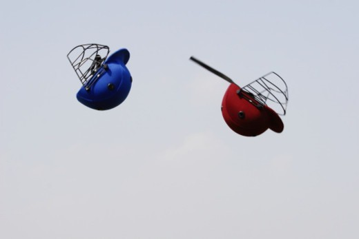 Stock Photo: 1491R-1176616 Two helmets in the air