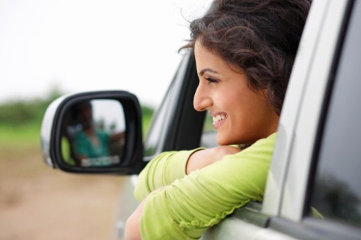 Stock Photo: 1491R-1176755 A woman looking out of a car window
