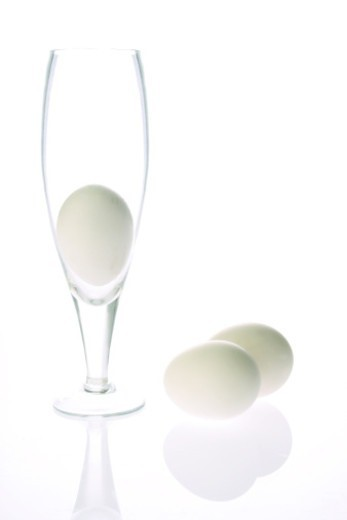 Three Eggs and a glass : Stock Photo