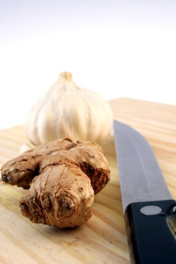 Ginger and garlic by a knife : Stock Photo