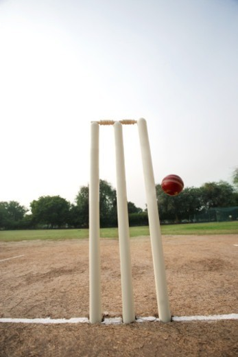 Stock Photo: 1491R-1177957 Cricket ball missing the stumps