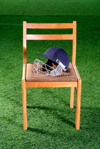 Cricket gear and a chair : Stock Photo
