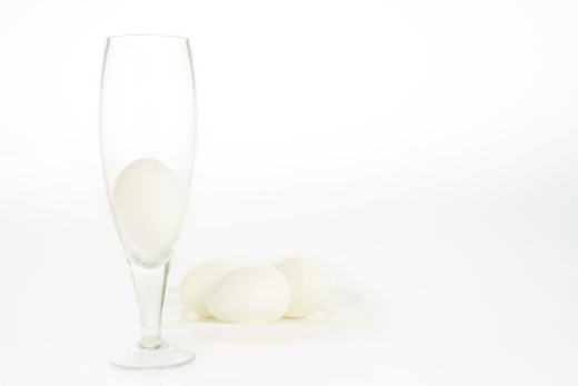 Eggs and a glass : Stock Photo