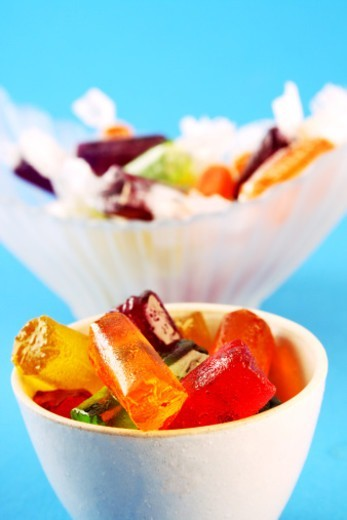 A small bowl of candies and a big bowl of candies : Stock Photo