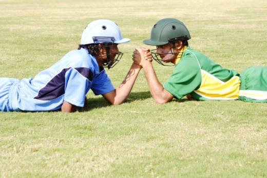 Stock Photo: 1491R-1178237 Cricket rivals engaged in arm wrestling