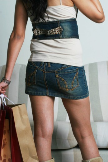 Stock Photo: 1491R-1178456 A woman carrying shopping bags