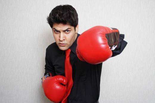 Stock Photo: 1491R-1178559 Portrait of a man wearing boxing gloves