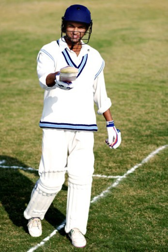 Stock Photo: 1491R-1179194 A batsman raising his bat after scoring