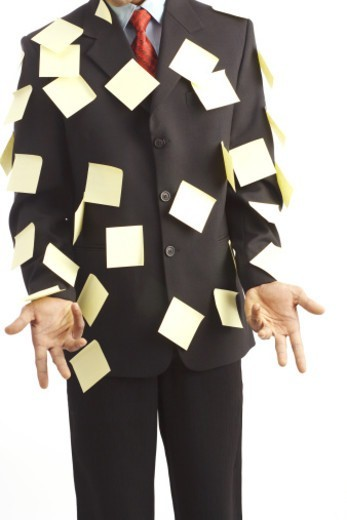 Stock Photo: 1491R-1179993 A Businessman with stick slips on him
