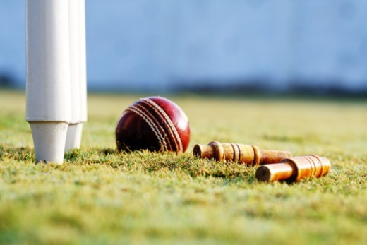 Stock Photo: 1491R-1180079 Partial view of the cricket stumps and a ball