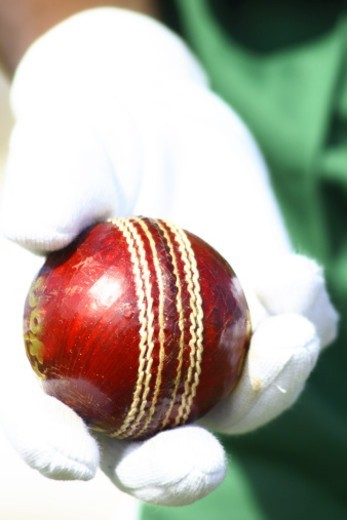Player holding a cricket ball : Stock Photo
