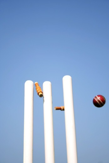 Stumps disturbed by a cricket ball : Stock Photo