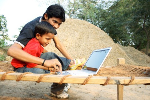 Stock Photo: 1491R-1181839 Father and son working on laptop