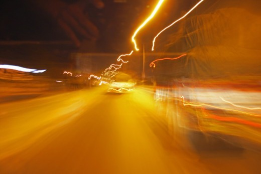 Stock Photo: 1491R-1181923 Distorted image of traffic at night