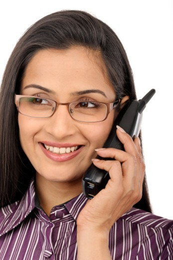 Young woman speaking on phone : Stock Photo