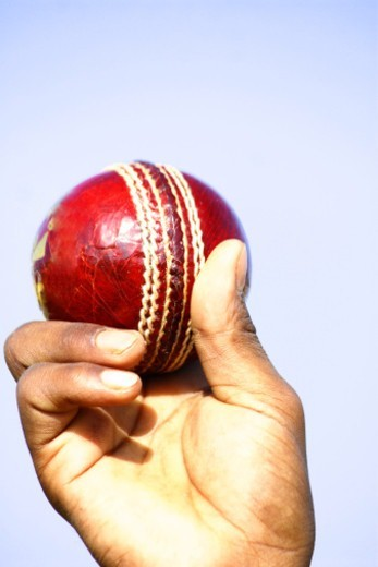 Stock Photo: 1491R-1182539 Person holding a cricket ball