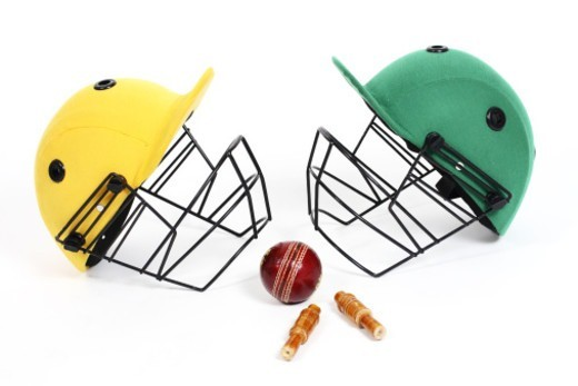 Stock Photo: 1491R-1182697 Two cricket helmets facing each other, studio shot