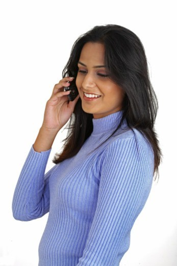 Young woman speaking over the cell phone : Stock Photo