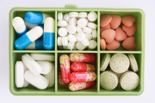 Stock Photo: 1491R-1183348 A box full of different medicines, Close-up