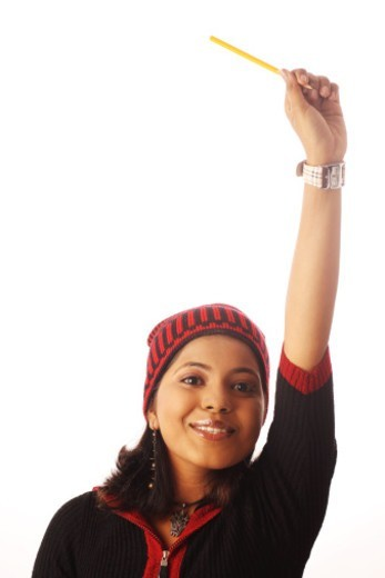 Stock Photo: 1491R-1183424 Young woman raising her hand up, portrait