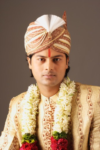 Stock Photo: 1491R-1183493 Waist-up of a Indian groom