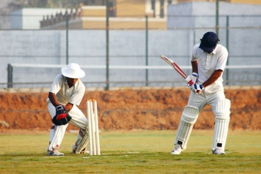 Stock Photo: 1491R-1183546 The wicketkeeper catches the ball left by the batsman