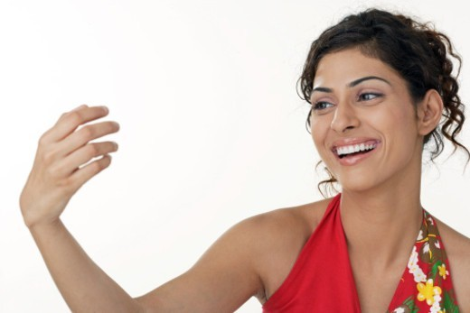 Stock Photo: 1491R-1183919 Young woman doing a hand gesture