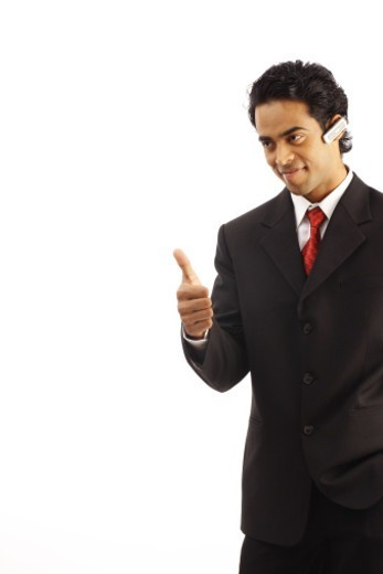 Stock Photo: 1491R-1184366 Young business man wearing hands-free device