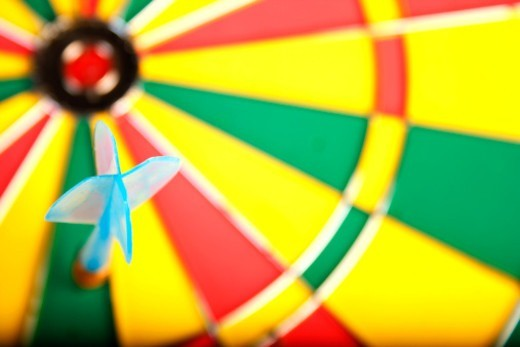Stock Photo: 1491R-1184397 Dart on dart board